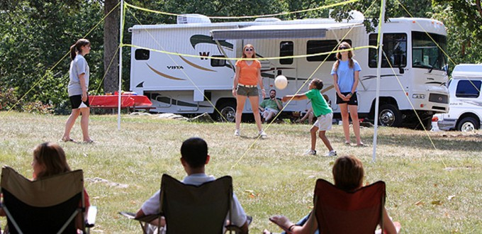 Family playing at campground