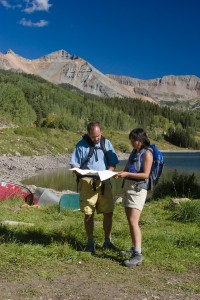 campers in colorado looking at a map to plan their hike