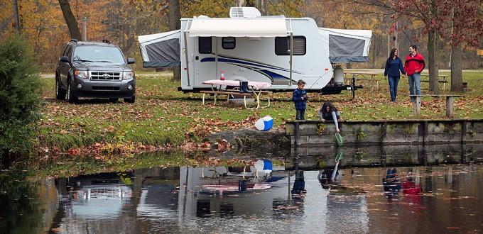 Expandable camper at lake